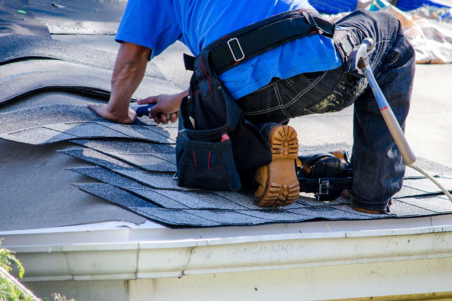 roofer working on a home rooftop